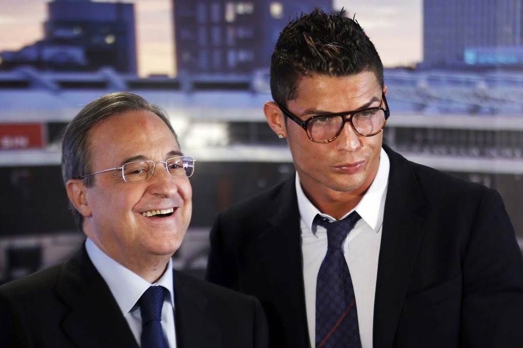 Real Madrid's Ronaldo poses beside club president Perez after a ceremony at Santiago Bernabeu stadium in Madrid